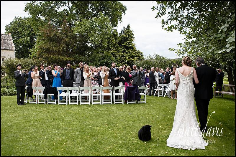 Arrival of the bride at an outdoor wedding ceremony at Friars Court