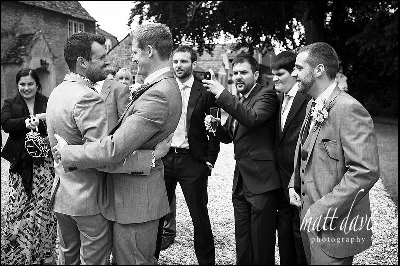 black and white photo of wedding guests at Friars Court