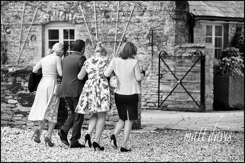 black and white documentary photo of wedding guests at Friars Court