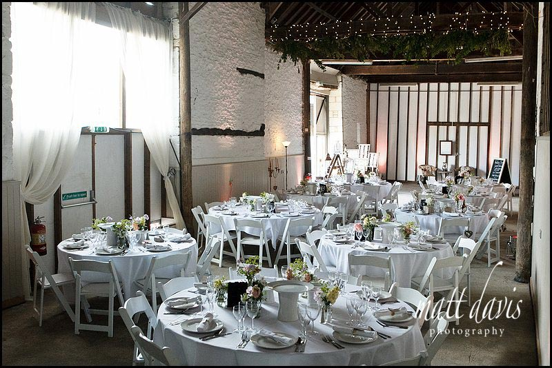 Friars Court barn with tables for wedding breakfast