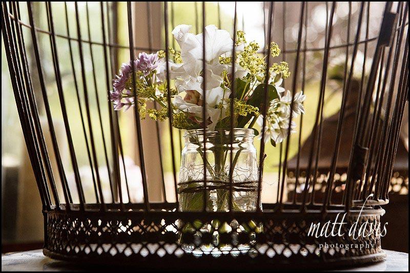 Vintage style wedding flowers in birdcage