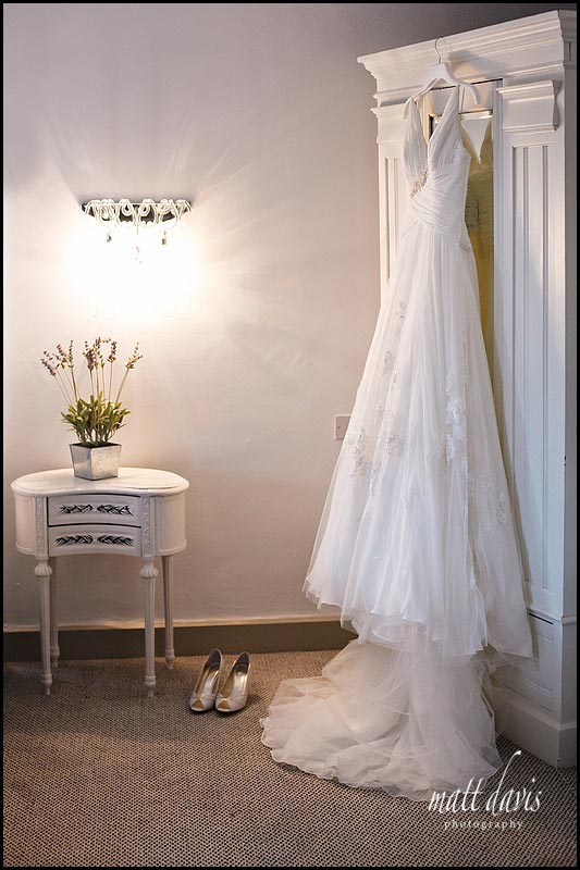 wedding dress hung on wardrobe in Cotswolds 88 Hotel