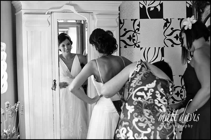 Bride dress being done up in room at Cotswolds 88 hotel