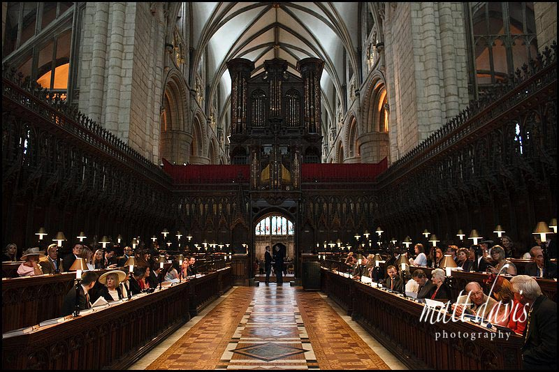 Guests at a wedding at Gloucester Cathedral