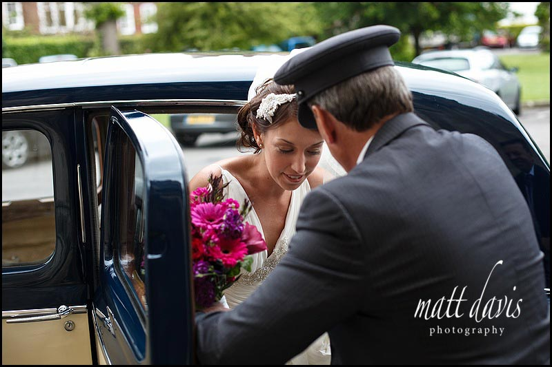 Bride departing vintage wedding car