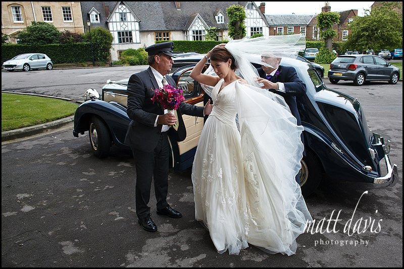 bride and vintage wedding car at Gloucester Cathedral