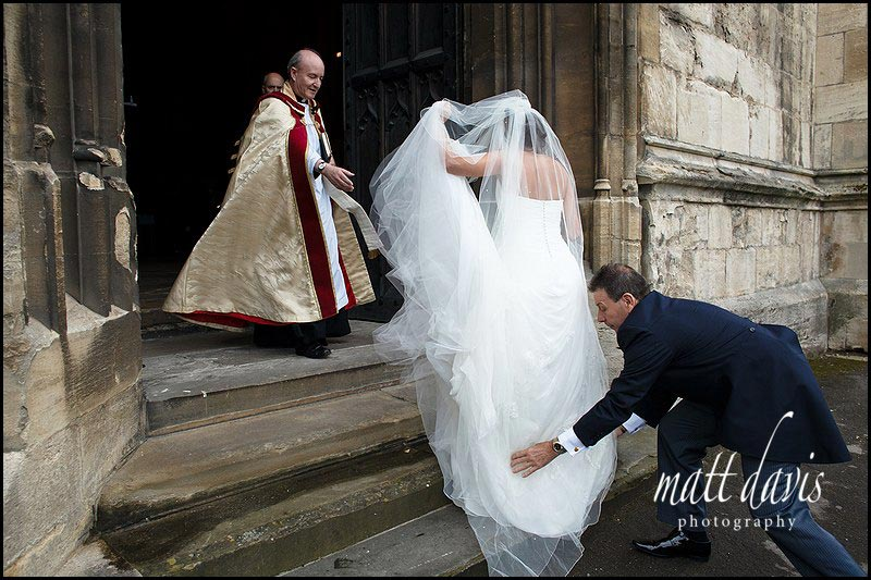 bride arriving at Gloucester Cathedral