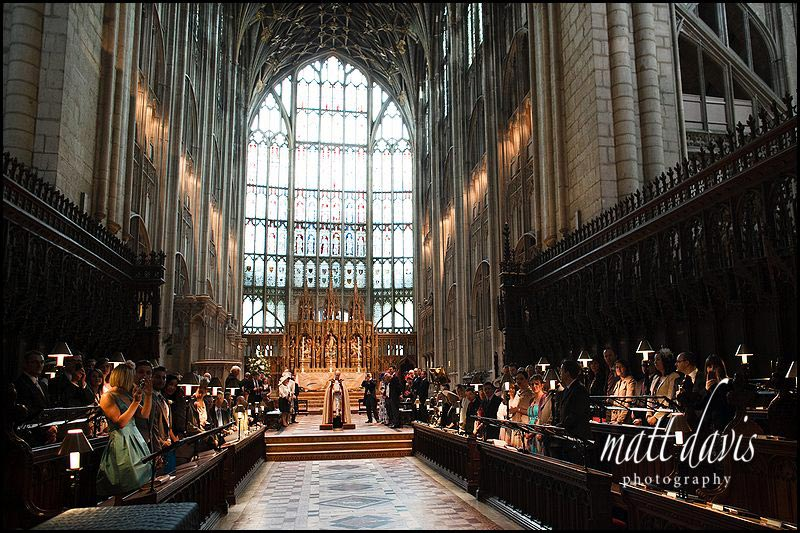 groom awaits brides arrival at Gloucester Cathedral