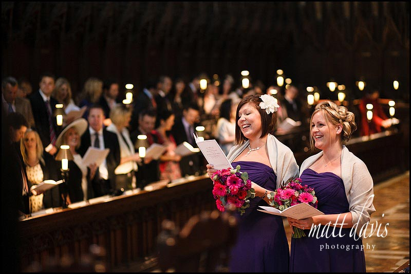bridesmaids singing during wedding at Gloucester Cathedral