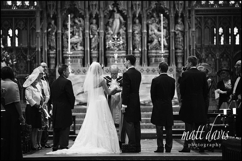 black and white photo of wedding ceremony at Gloucester Cathedral