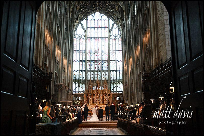 Large photo of wedding ceremony at Gloucester Cathedral
