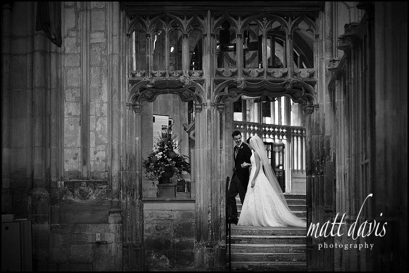 bride and groom inside Gloucester Cathedral