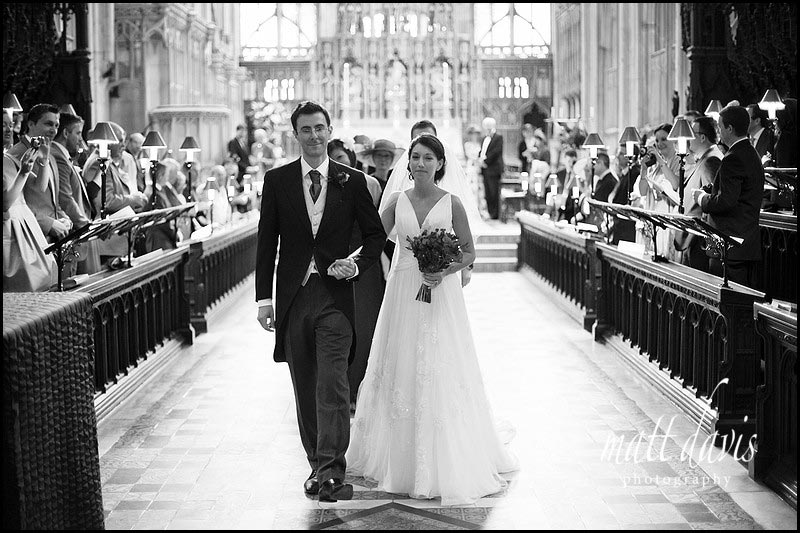 bride and groom leaving wedding ceremony at Gloucester Cathedral