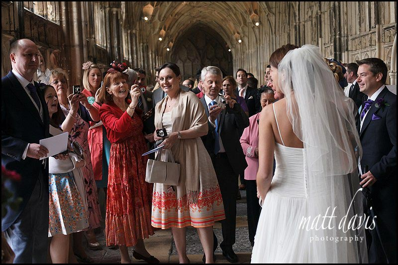 photos of Wedding guests in the cloisters at Gloucester Cathedral