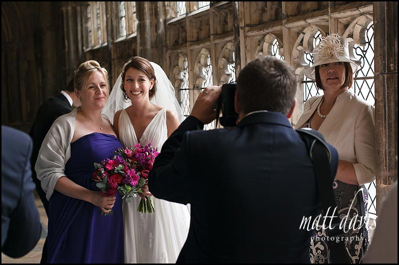 bride and bridesmaid in the cloisters at Gloucester Cathedral