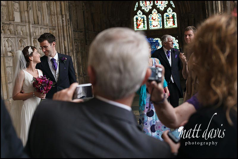 documentary wedding photography of married couple at Gloucester Cathedral