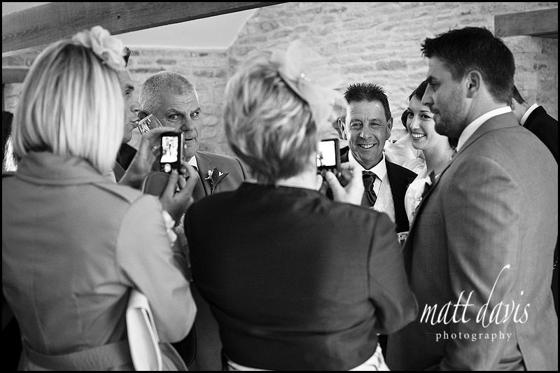Wedding drinks reception photos indoors at Kingscote Barn