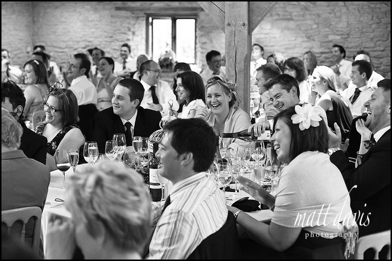 wedding guests during speeches at Kingscote Barn