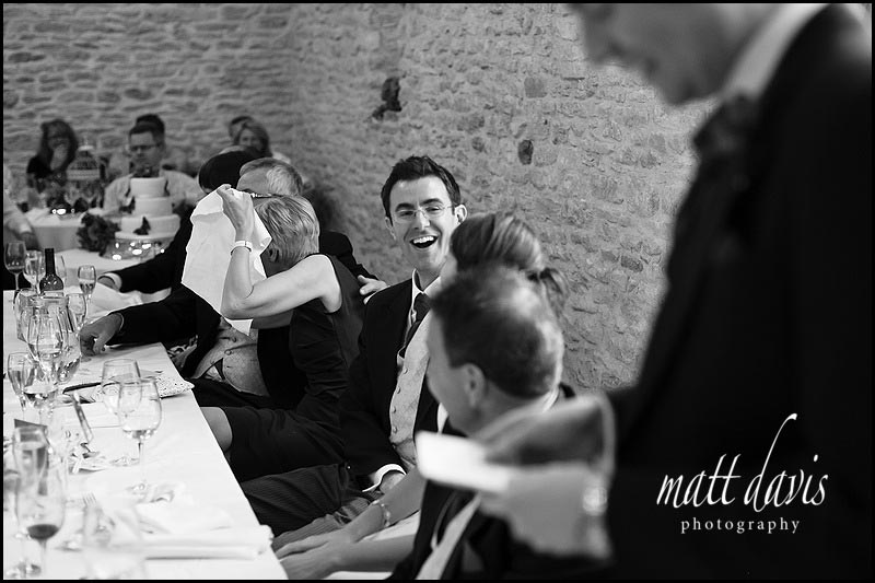 documentary photography of wedding speeches at Kingscote Barn