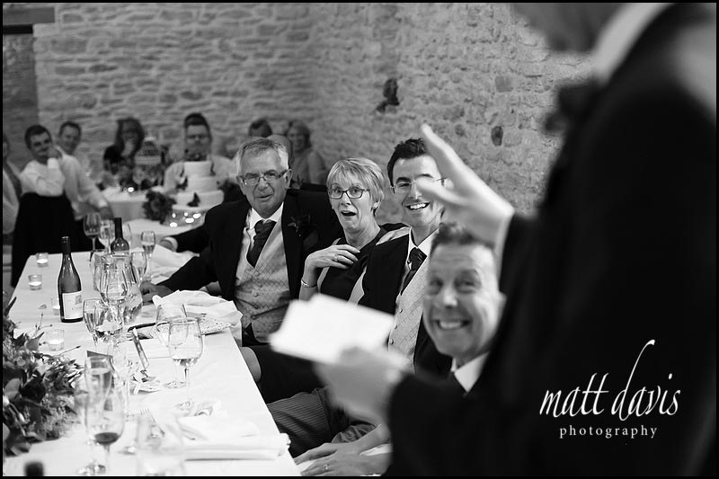 documentary photographers photos of wedding speeches at Kingscote Barn