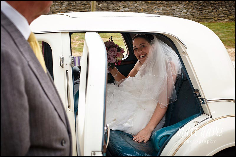 Bride arriving at Stone Barn Aldsworth wedding