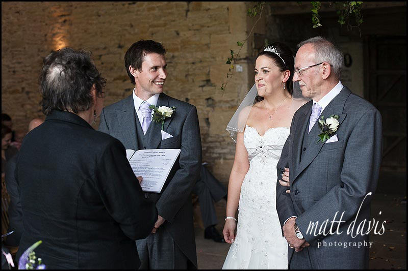 Stone Barn wedding photos during ceremony