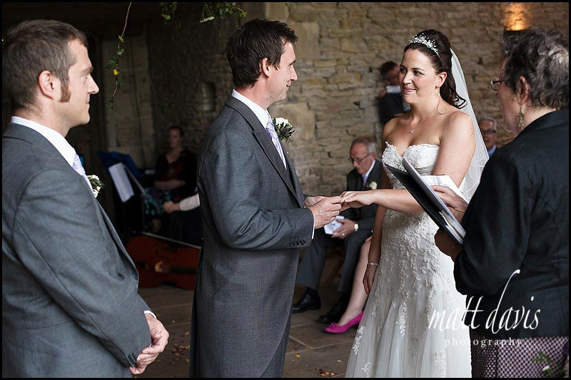 Exchange of rings at Stone Barn wedding ceremony
