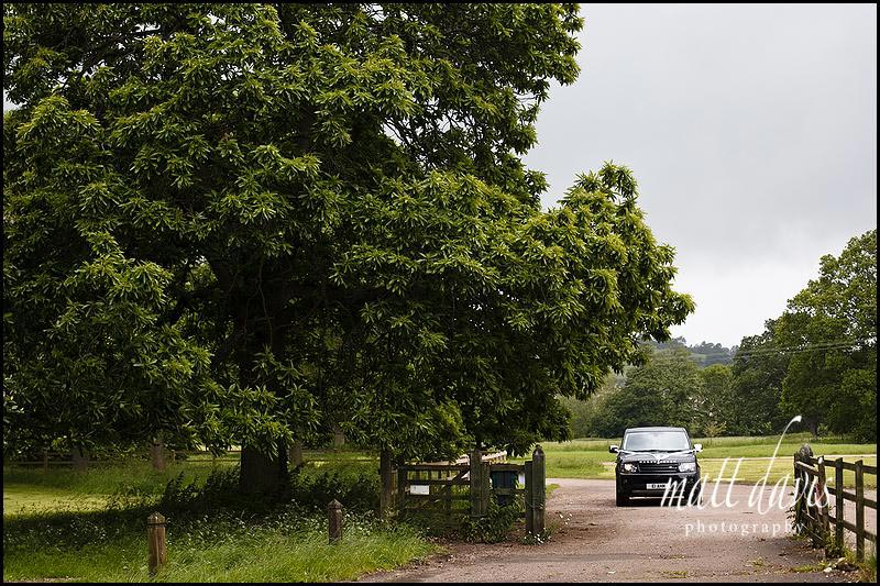Black wedding car arriving at Sudeley Castle