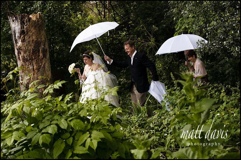 White wedding umbrellas heart shaped