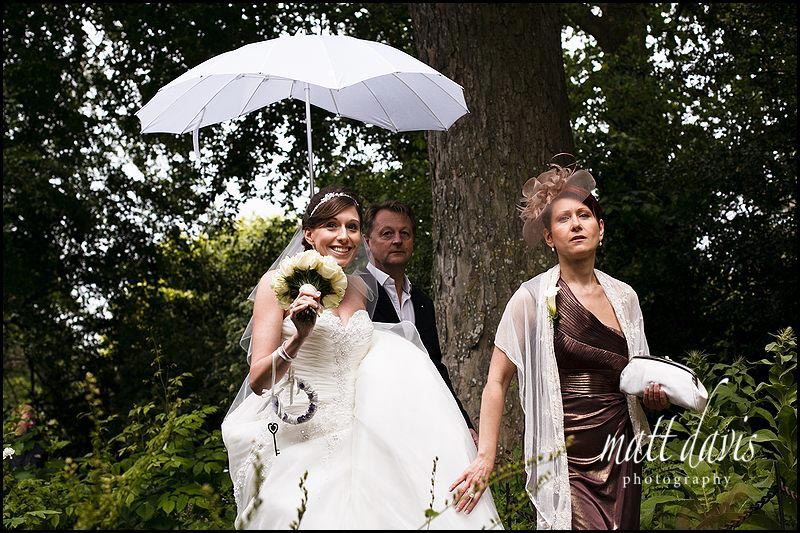 bride before the wet outdoor wedding ceremony at Sudeley castle