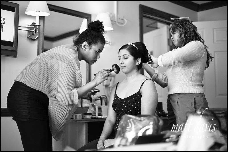 Bride having wedding hair and make-up done at the same time