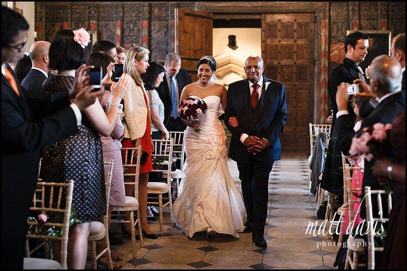 bride entering the civil ceremony at Berkeley Castle