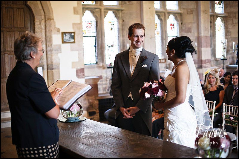 groom smiling during a civil ceremony at Berkeley Castle