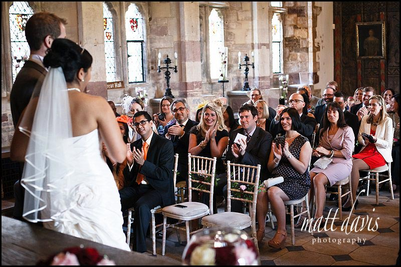 Berkeley Castle wedding guests clapping married couple