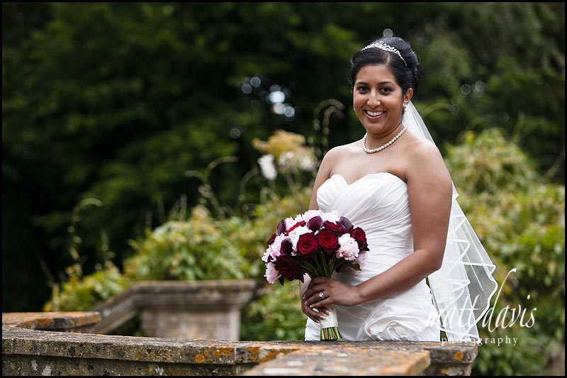 bride with wedding bouquet in Berkeley Castle gardens