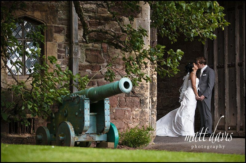 wedding couple kissing at Berkeley Castle weddings