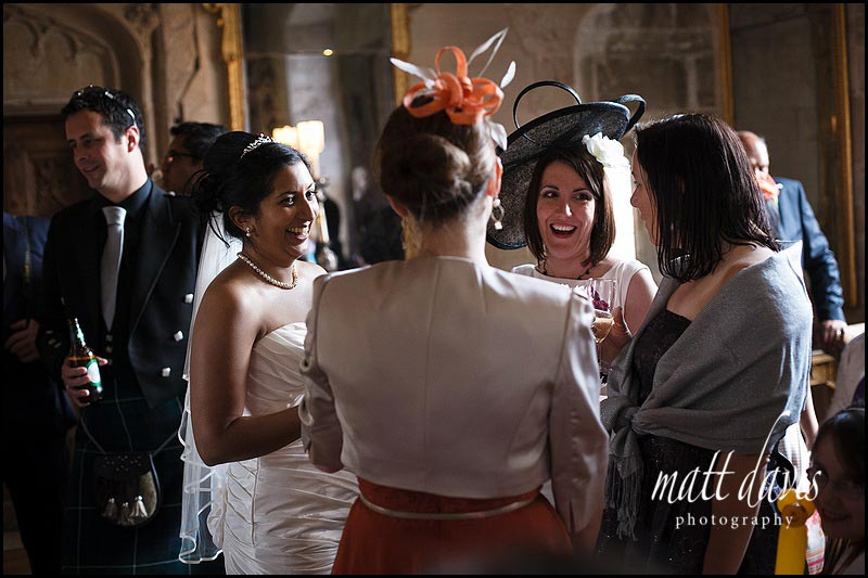 wedding guests inside Berkeley Castle during the drinks reception