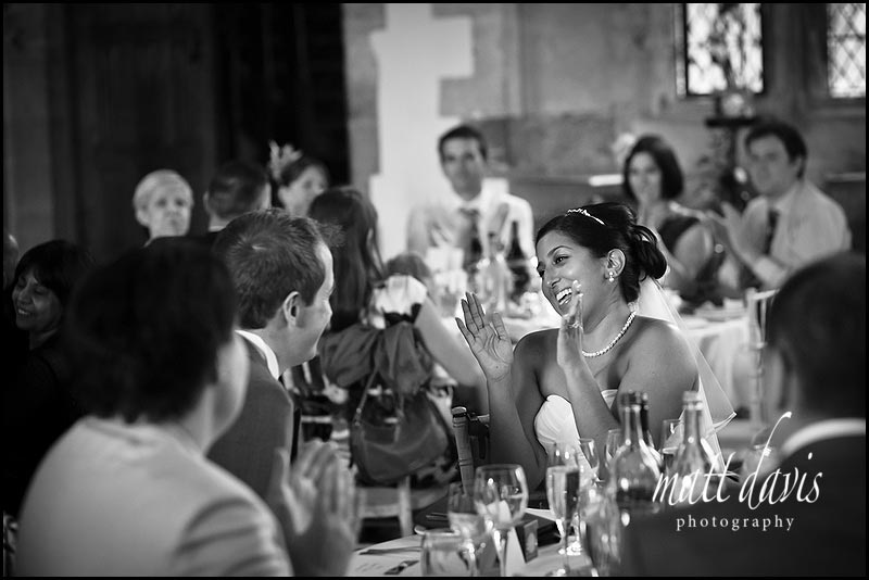 Excited bride during wedding speeches at Berkeley Castle