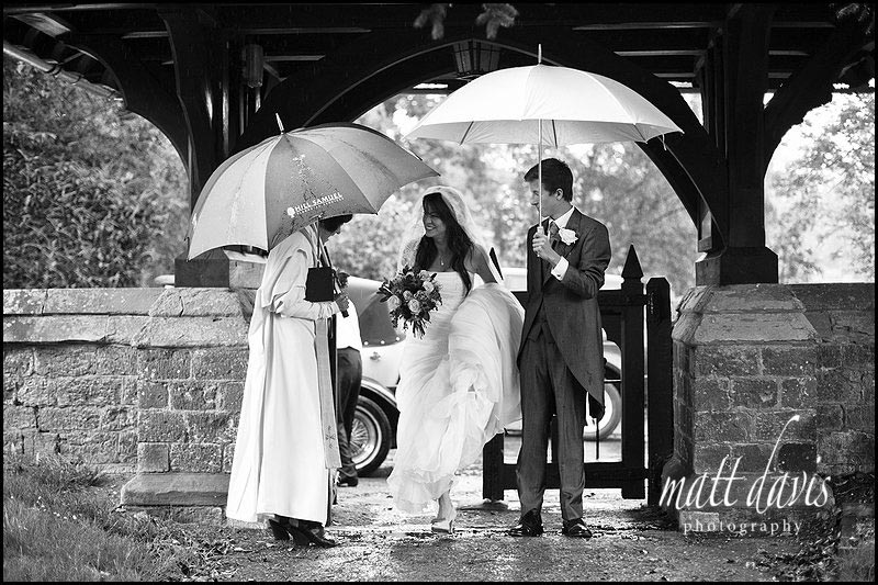 Eastnor Castle wedding photos in rain