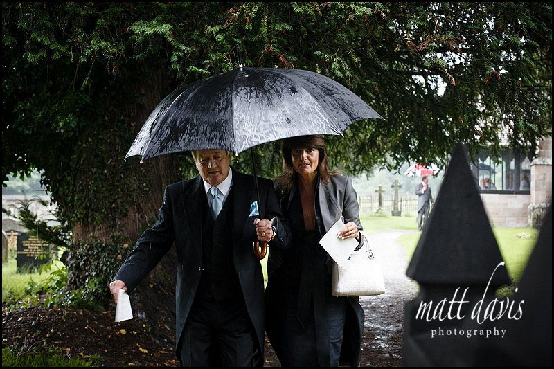 Wet wedding at Eastnor Church