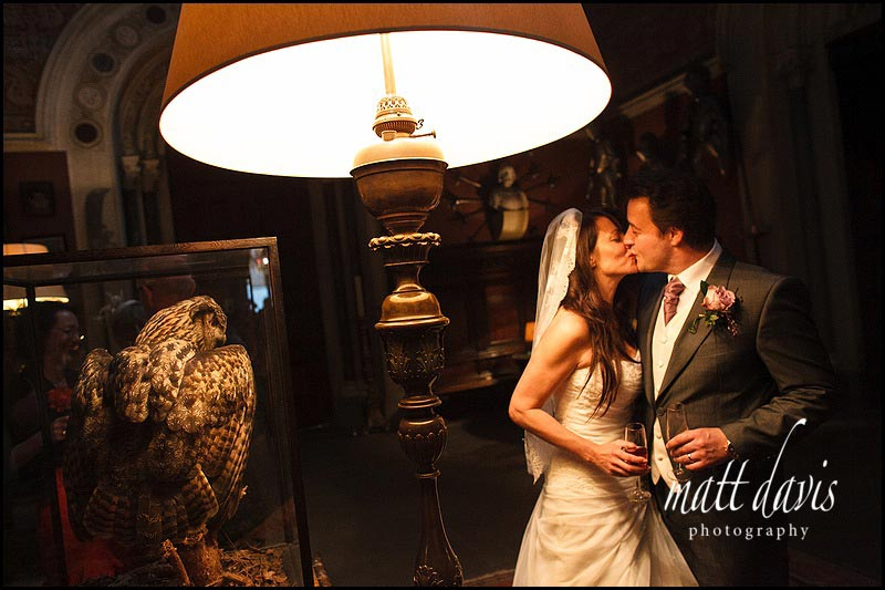 Wedding couple kiss at Eastnor Castle wedding
