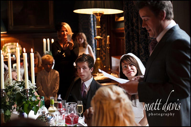candle lit wedding speeches at Eastnor Castle