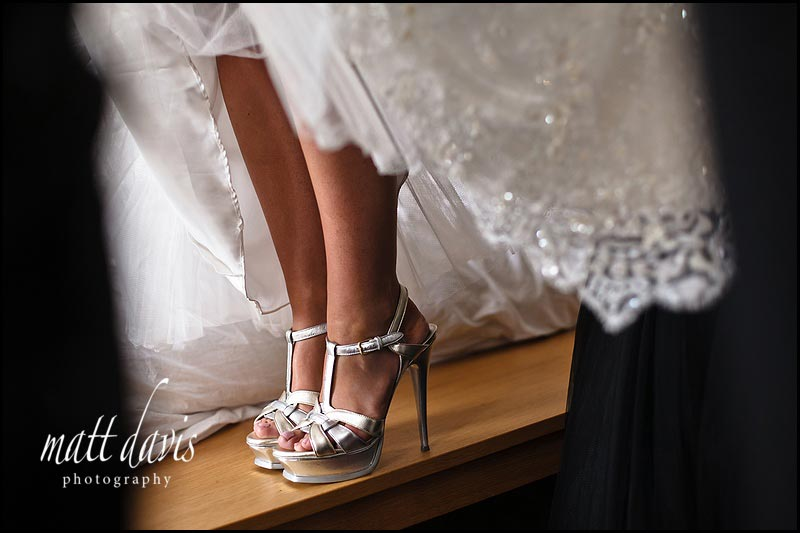 Silver brides shoes with very high heal
