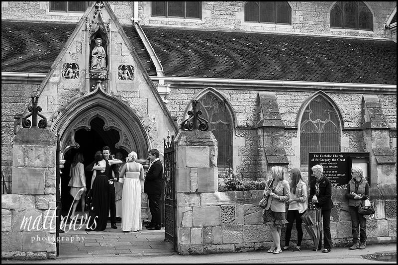 Wedding guests at St Gregory's Church, Cheltenham, Gloucestershire