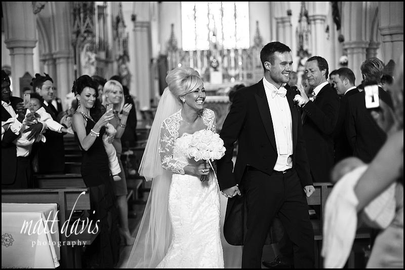 happy wedding couple leaving  St Gregory's Church, Cheltenham