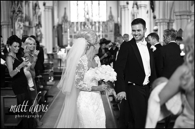 wedding couple leaving  St Gregory's Church, Cheltenham