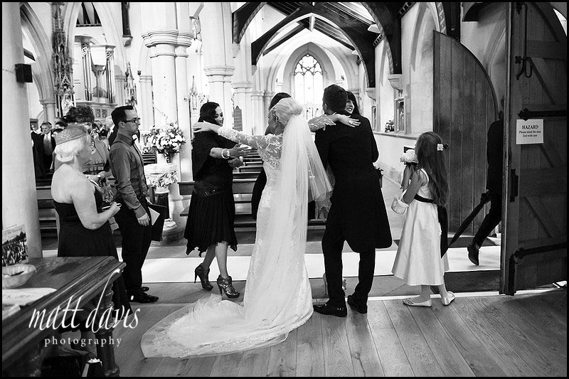 wedding guests at St Gregory's Church, Cheltenham