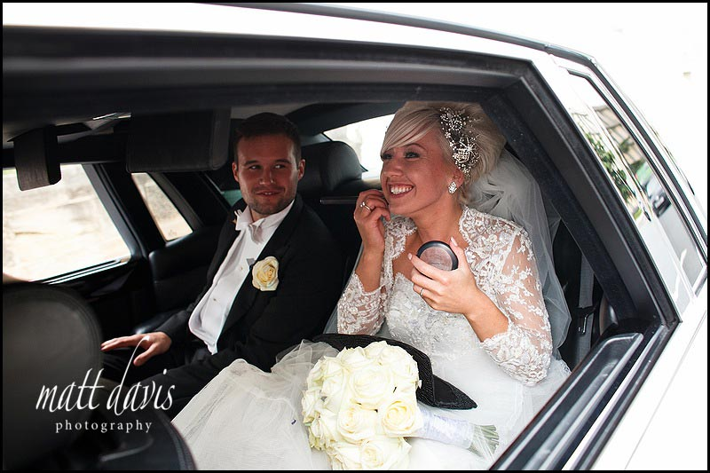 Wedding make-up being applied in the wedding car