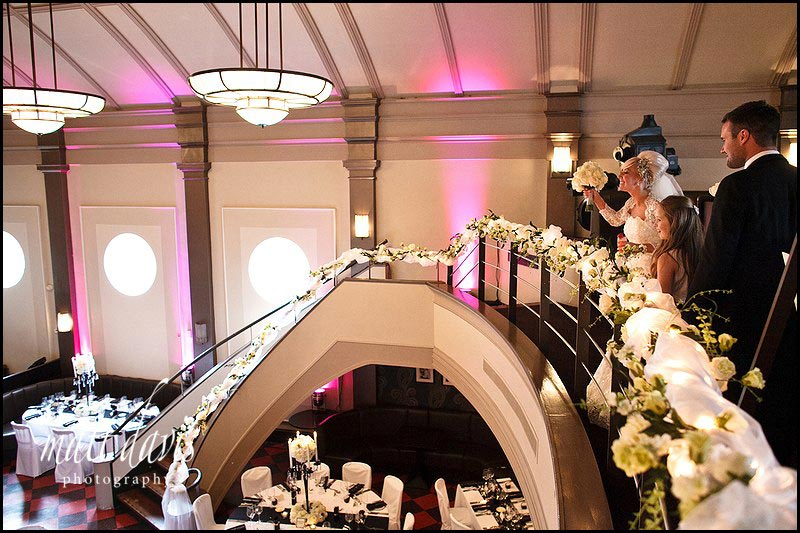 Wedding Couple Looking At The Table Arrangements Inside Daffodil Cheltenham