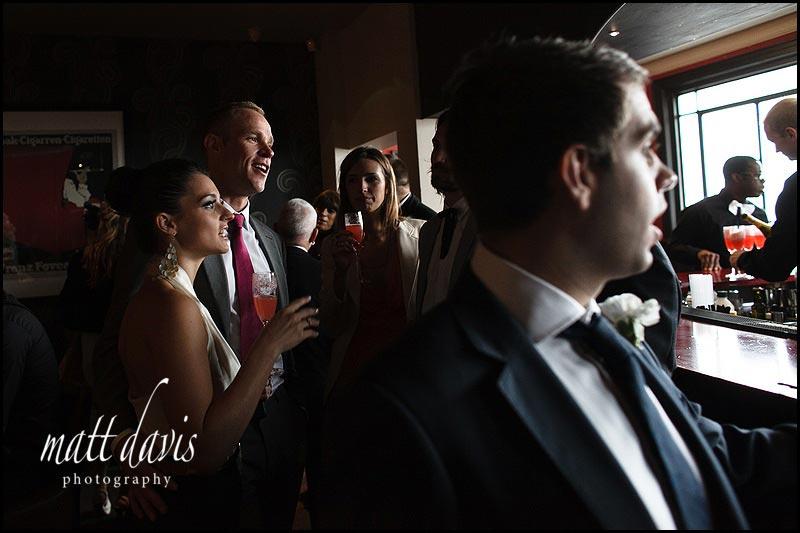 Wedding guests at the bar at the daffodil wedding